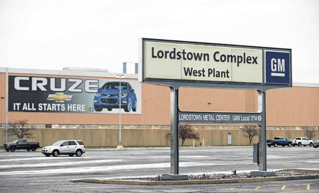In this Nov. 27, 2018 photo, a sign is displayed at General Motors Lordstown West plant in Lordstown, Ohio. It was working-class voters who bucked the area's history as a Democratic stronghold and backed Donald Trump in 2016, helping him win the White House with promises to put American workers first and bring back disappearing manufacturing and steel jobs. Whether they stick with him after this week's GM news and other signs that the economy could be cooling will determine Trump's political future.