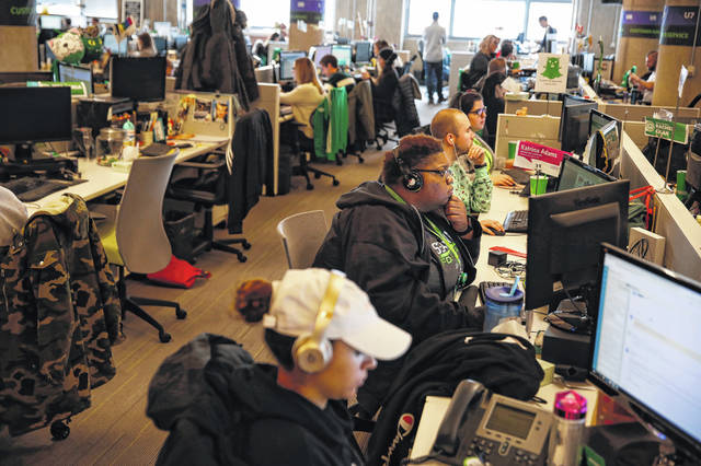 The customer service department at Groupon in Chicago handles customer requests on Nov. 14. The game-changing online company turns 10 as a smaller operation from its peak.