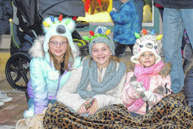 Sofia, Lillian and Angelina Seibert, from Spencerville, enjoy their first Bluffton Blaze of Lights.