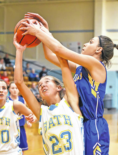 Bath's Ruby Bolon fights for a rebound against Findlay's Kristen Scherger during Friday night's Kewpee Tip Off Classic at Bath High School.