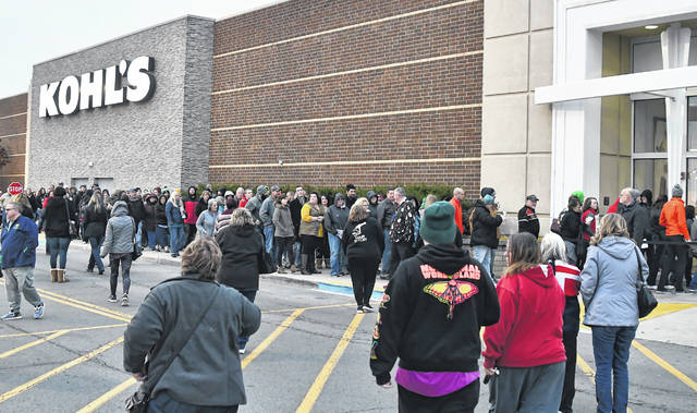 Shoppers wait in line at Kohl's to enter the store Thanksgiving Day to be the first to get early Black Friday deals