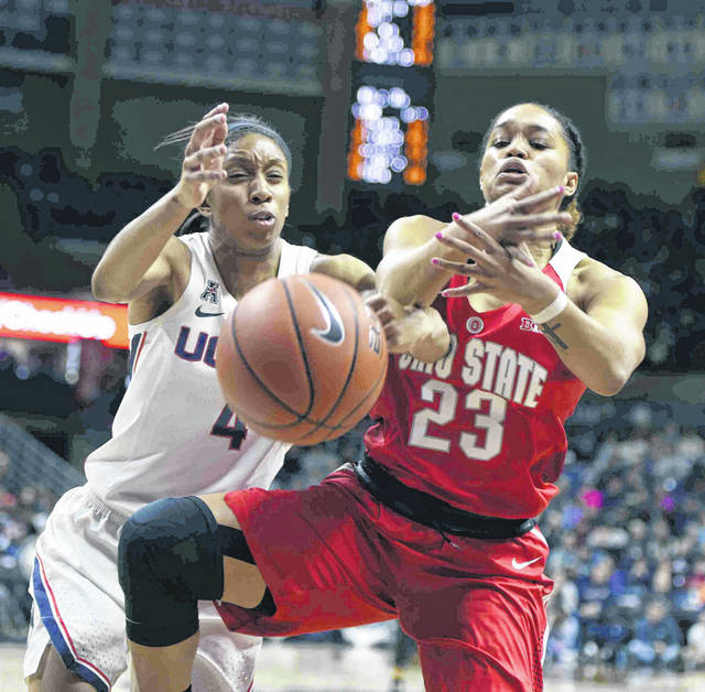 Connecticut's Mikayla Coombs (4) and Ohio State's Najah Queenland (23) battle for a rebound in the second half of a women's NCAA college basketball game, Sunday, Nov. 11, 2018, in Storrs, Conn.(AP Photo/Stephen Dunn)