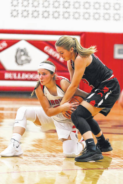 Columbus Grove's Kenzie King, left, and Shawnee's Tessa Jordan battle for the ball during Tuesday night's game at Columbus Grove.