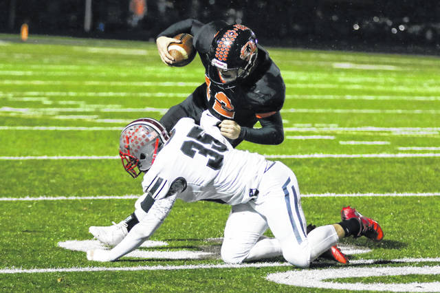 Columbus Grove's Riley Schumacher tackles Seneca East's Chase Foos during Friday night's Division VI, Regional 22 semifinal at Frost-Kalnow Stadium in Tiffin.