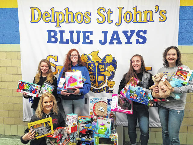 Delphos St. John's students recently completed a toy drive. Pictured are, kneeling, Cassidy Schafer, and back from left, Amber Palte, Nichol Pohlman, Abby Hensley and Abby Bonifas.