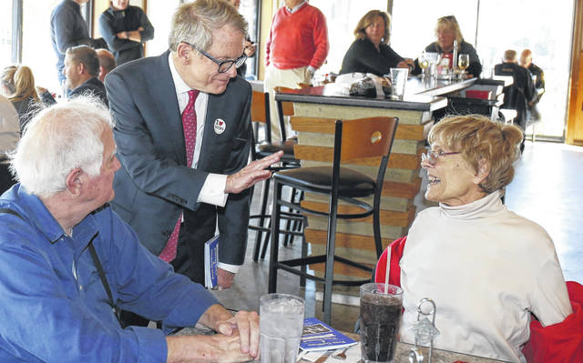 Ohio Republican gubernatorial candidate Mike DeWine, center, greets diners at Price Hill Chili, Tuesday, Nov. 6, 2018, in Cincinnati, Ohio. (AP Photo/Gary Landers)