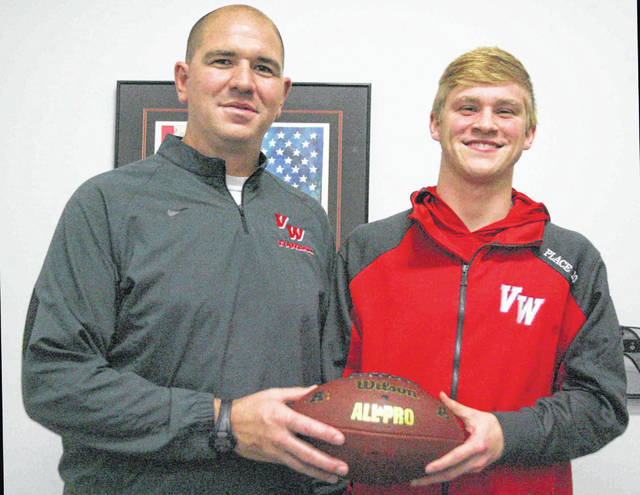 Van Wert head coach Keith Recker (left) and Cougar quarterback Nate Place (right) were recognized as the coach and player of the year, respectively. Van Wert went 8-2 during the regular season and made its first appearance in the postseason since 2000. The Cougars also won their first playoff game.
