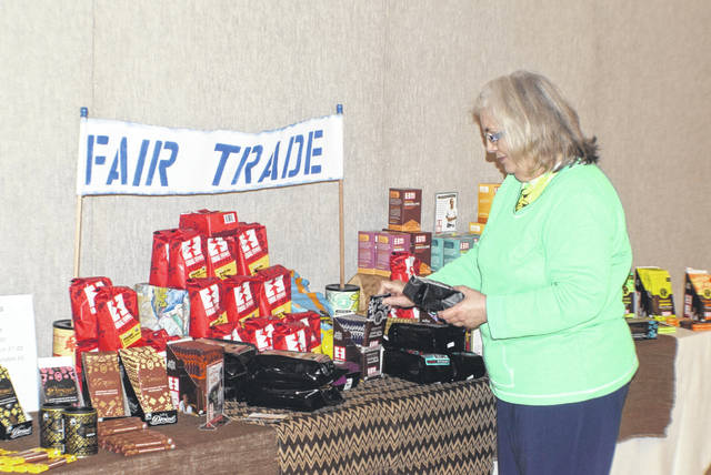 Deb Parker looks over some chocolate and coffee at the Fair Trade Sale at St. Joseph Church Parish Life Center in Wapakoneta.