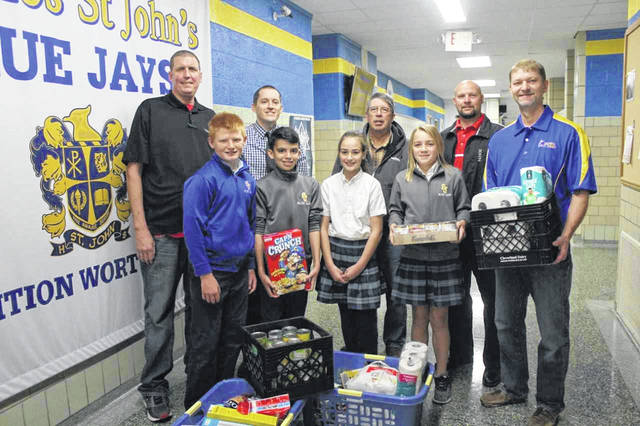 Members of the WE team at Delphos St. Johns collected items for the St. VIncent de Paul food pantry.