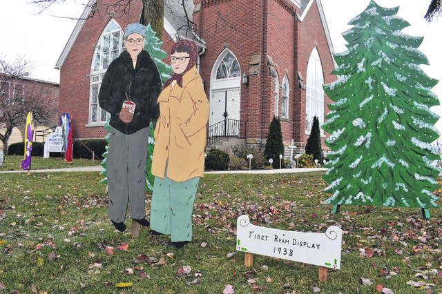 One of the wooden cutouts is of Harry and Dorothy Ream, whose folk art display is the centerpiece of the Bluffton Blaze of Lights.
