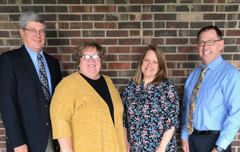 Western Buckeye ESC Superintendent Dave Bagley, Crestview Superintendent Kathy Mollenkopf and Lincolnview Superintendent Jeff Snyder welcome Jennifer Daugherty to her new position as social worker for both schools.