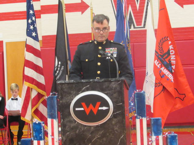 Retired U.S. Marine Corps Col. Jeffery Goodes speaks during a Veterans Day ceremony Monday at Wapakoneta Middle School.