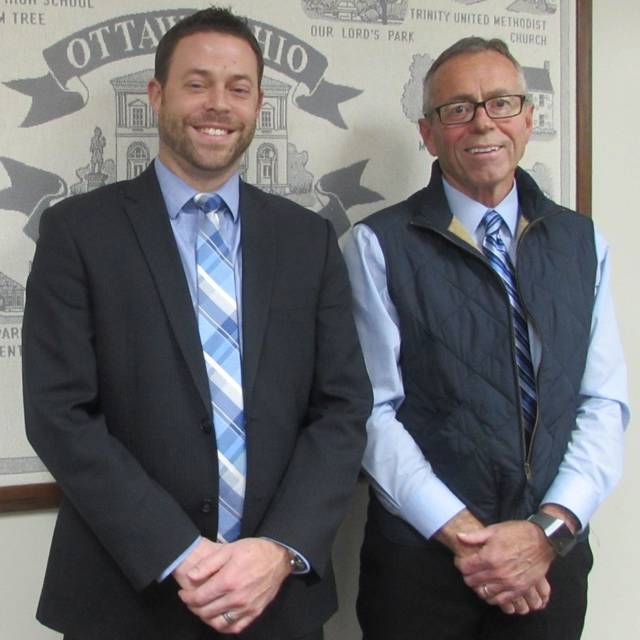 Outgoing Ottawa-Glandorf High School principal Jayson Selgo, left, poses for a photo with his interim replacement, Mark Fuerst after the school board approved Fuerst's appointment Wednesday.