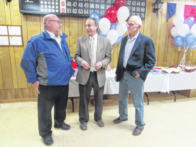 Putnam County Commissioners, from left, Michael Lammers, John Love and Vincent Schroeder share a laugh during a party Friday night at the Ottawa VFW to honor Love.