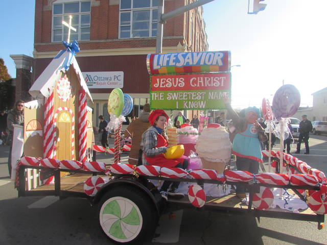 Members of Breakthrough Harvest Community Church won first place for their float in Sunday's Santa parade in Ottawa.
