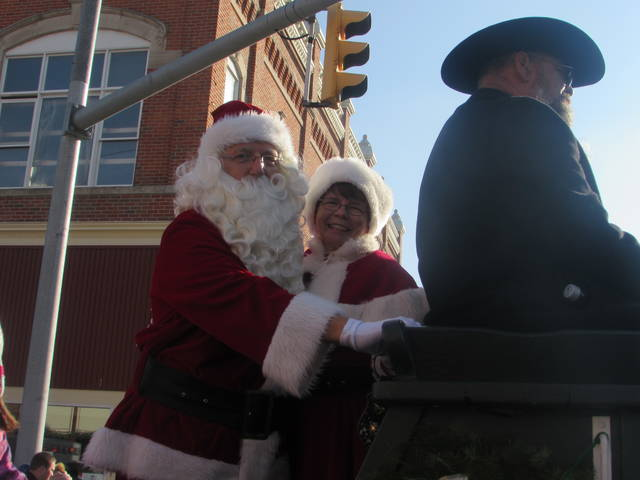 Mr. and Mrs. Claus greet parade goers during the 26th annual Welcome Santa Christmas Parade Sunday in Ottawa.