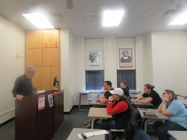 "James McCrone, Philadelphia suspense-thriller author, speaks to Intro to Government students Friday at Ohio Northern University about his book, ""Faithless Elector."""