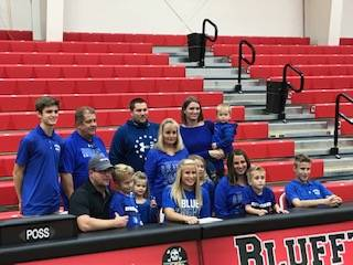 Alivia Koenig signs her letter of intent to play golf & basketball at Urbana University. Submitted photo
