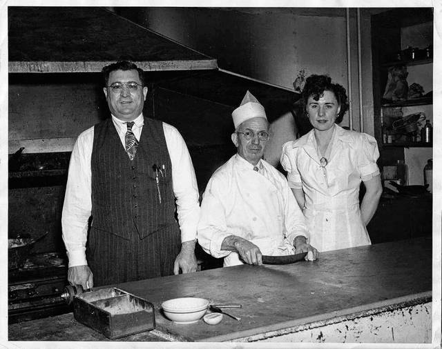 "Frank Guagenti, Ettore ""Chef Boyardee"" Boiardi and longtime employee Goldie Rundio pose for a photo in Milano's North Main Street location in an unknown year."