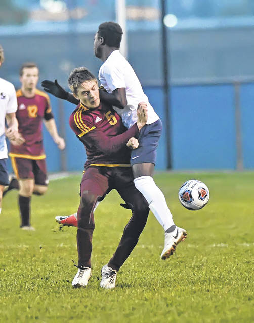 Kalida's Grant Laudick, left, and Archbold's Sonson Nafziger collide during Wednesday night's Division III regional semifinal at Graham Memorial Soccer Stadium in Findlay.