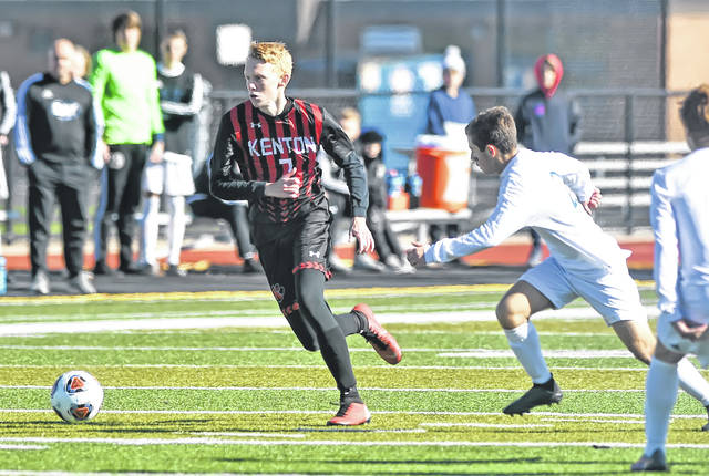 Kenton's Kobe Kirk gets past Bay's Aidan Bozak during Saturday's Division II regional final at Firelands Stadium in Sandusky. See more soccer photos at LimaScores.com.