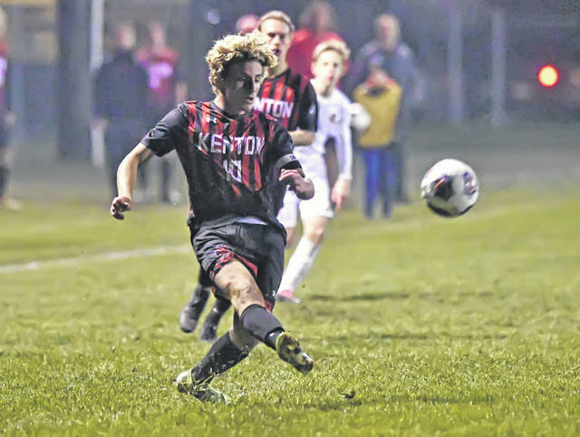 Kenton's Landon Bartlett takes a shot during Wednesday night's Division II regional semifinal against Toledo Central Catholic at Graham Memorial Soccer Stadium in Findlay. See more soccer photos at LimaScores.com.