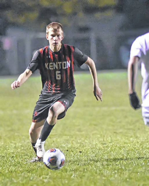 Kenton's Reed Cook controls the ball during Wednesday night's Division II regional semifinal against Toledo Central Catholic at Graham Memorial Soccer Stadium in Findlay.