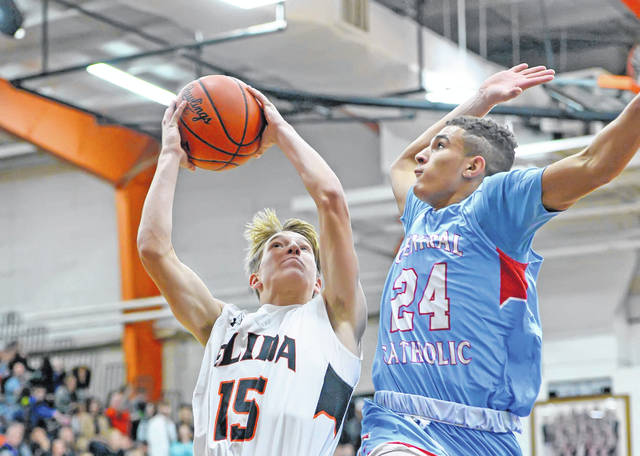 Elida's Evan Unruh puts up a shot against Lima Central Catholic's Rossy Moore during Friday night's Mercy Health Elida Tip-Off Classic.