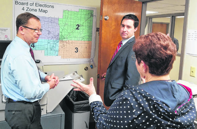 Frank LaRose, middle, Ohio's next secretary of state, visited with Allen County Allen County Board of Elections Director Kathy Meyer, right, and Deputy Director Mark Vernik during a visit in April. LaRose said he wouldn't second-guess Jon Husted's process of purging names from the elections list but hopes to make future large-scale purges unnecessary once he's in office.
