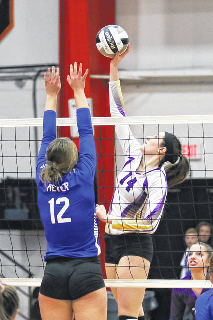 Leipsic's Hayley Heitmeyer of Leipsic hits a shot against Tiffin Calvert's Zoe Meyer during Saturday's Division IV regional final at the Elida Fieldhouse. See more volleyball photos at LimaScores.com.