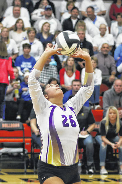 Leipsic's Selenda Loredo sets the ball during Saturday's Division IV regional final against Tiffin Calvert at the Elida Fieldhouse.
