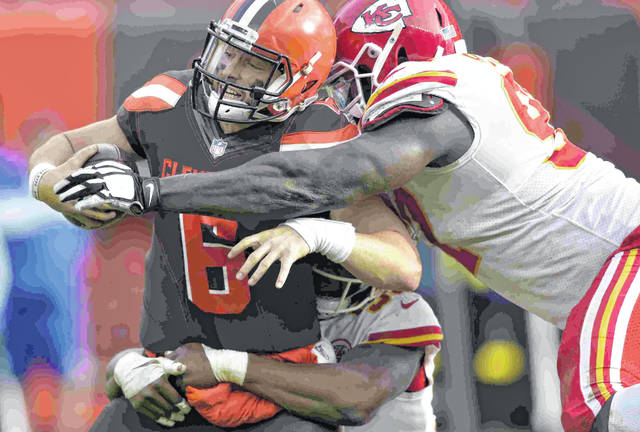 Cleveland Browns quarterback Baker Mayfield (6) attempts a two-point conversion as Kansas City Chiefs defensive end Allen Bailey (97) makes the tackle during the second half of an NFL football game Sunday, Nov. 4, 2018, in Cleveland. The attempt failed. (AP Photo/David Richard)