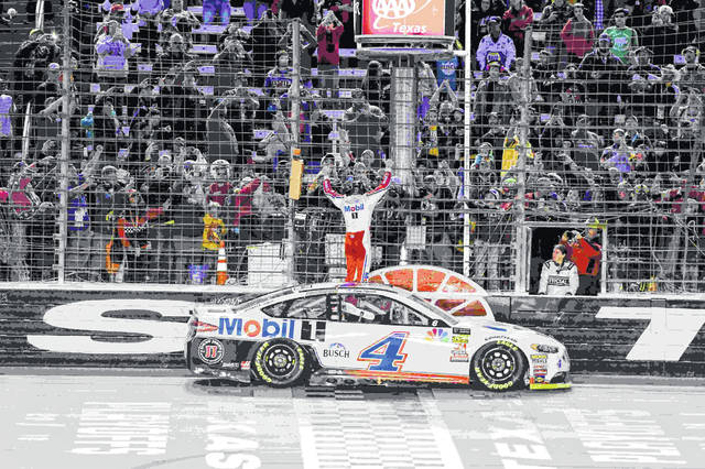 Kevin Harvick celebrates with fans after winning a NASCAR Cup auto race at Texas Motor Speedway, Sunday, Nov. 4, 2018, in Fort Worth, Texas. (AP Photo/Larry Papke)