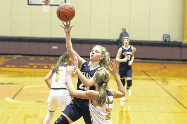 Ottawa-Glandorf's Kasey Ellerbrock puts up a shot against Kalida's Brenna Smith during on Friday night's game in Kalida.
