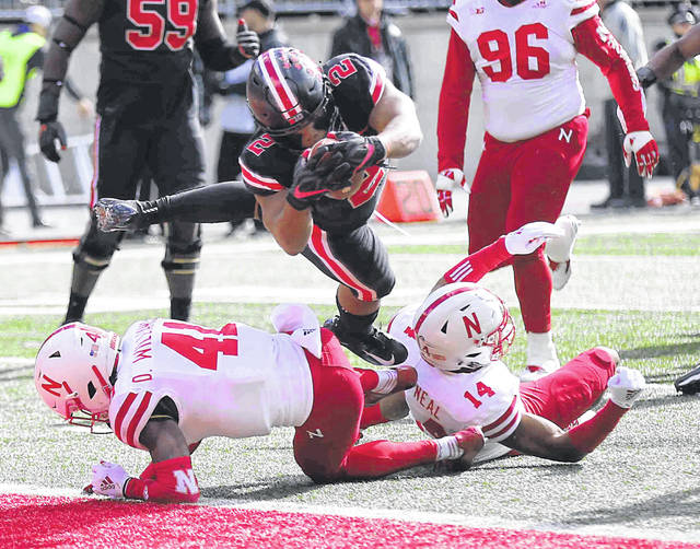 Ohio State's J.K. Dobbins dives for a touchdown against Nebraska's Deontai Williams (41) and Tre Neal during Saturday's game at Ohio Stadium in Columbus. See more Ohio State photos at LimaScores.com.