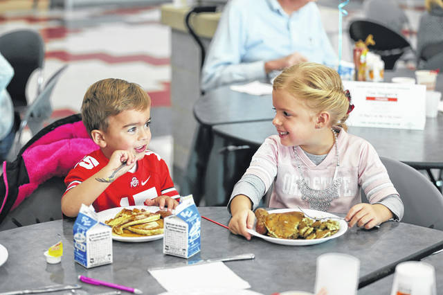 Ava Moran and Braxton chow down during the 60th annual Sertoma Club Pancake Day in 2016.