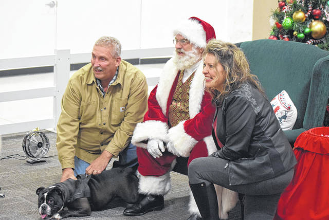 Kevin and Sherri Bishop brought Bella to pose with Santa at the Lima Mall.