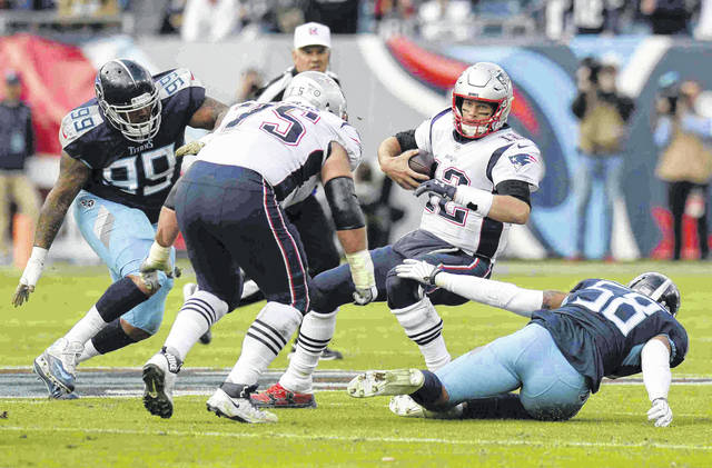 New England Patriots quarterback Tom Brady (12) is sacked by Tennessee Titans linebacker Harold Landry (58) for an 11-yard loss in the first half of an NFL football game Sunday, Nov. 11, 2018, in Nashville, Tenn. (AP Photo/Mark Zaleski)