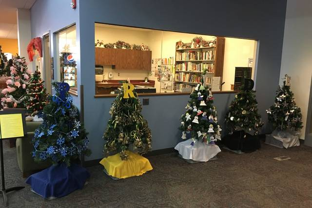 Pictured are Chrismas trees decorated by Ottawa Elementary School during the 2017 Christmas Tree Festival at the Putnam County Library.