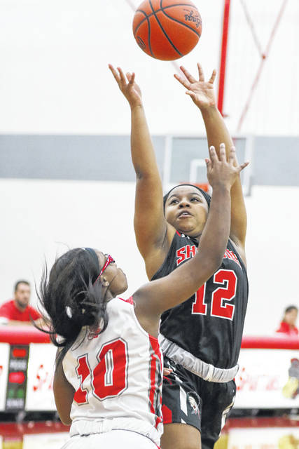 Shawnee's Samya Wright puts up a shot against Lima Senior's Nakiya Sigman during Thursday night's game at Lima Senior.
