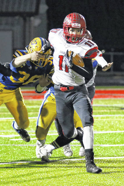 St. Marys' Eddie Fowler makes a diving attempt to stop Van Wert's Tanner Barnhart during Friday night's Division IV, Region 14 semifinal at Spartan Stadium.