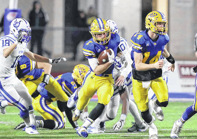 St. Marys' Sean Perry looks for running room as Braeden Dunlap (14) leads the way during Saturday night's Division IV state semifinal against Cincinnati Wyoming at Alexander Stadium in Piqua.