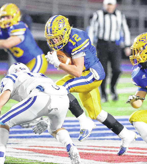 St. Marys' Ty Howell carries the ball during Saturday night's Division IV state semifinal against Cincinnati Wyoming at Alexander Stadium in Piqua.