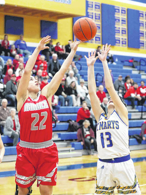 St. Marys' Lauren Cisco and New Knoxville's Erin Scott fight for a rebounds during Thursday night's game at St. Marys.