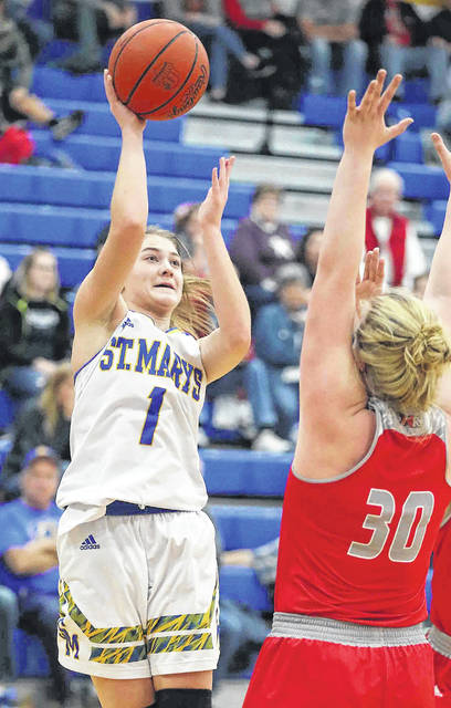 St. Marys' Carly Caywood puts up a shot against New Knoxville's Megan Jurosic during Thursday night's game at St.Marys.