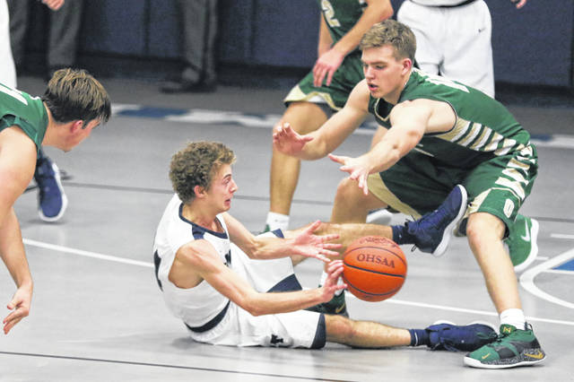 Ottoville's Josh Thorbahn defends Temple Christian's Brody Bowman during Friday night's game at Temple Christian.