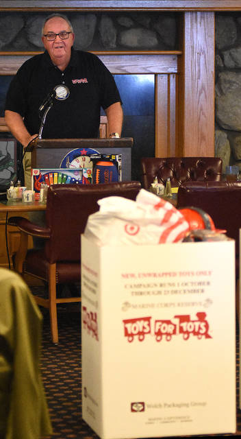 Lima Noon Optimist Bill Lewis kicks off the 2018 Toys For Tots campaign with the Salvation Army during their luncheon at the Elks Club on Wednesday.