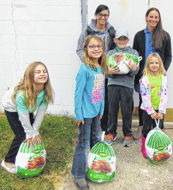 Children at Gospel Tabernacle Seventh Day Adventist Church helped fill food baskets for the needy recently.