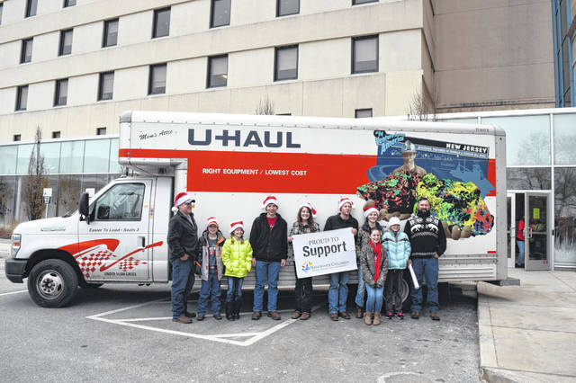 Organizers Tyler and Monica Slaven, of DeGraff, along with fellow volunteers are ready to unload the 3,000 toys they collected for last years toy drive. This year, Tyler's goal is to collect 6,000 toys.