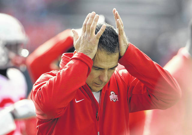Ohio State Coach Urban Meyer's sideline demeanor has taken on a decidedly beleaguered stoop this season. His motions are often followed by a hand moving up to the left side of his head because of severe headaches.
